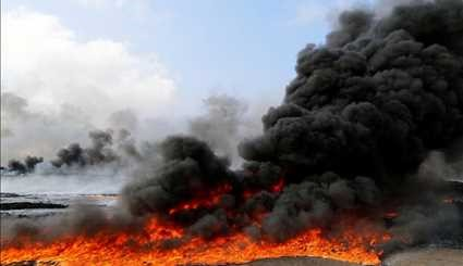 Iraqi Firefighters Extinguish Burning Oil Well