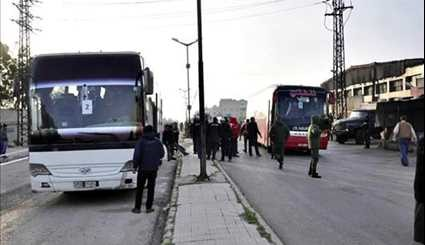 Syria: Tens of Gunmen, Family Members Leave Homs