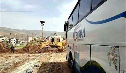 92 Buses Arrive in Zabadani, Madaya to Evacuate Militants, Their Families