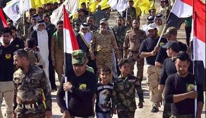 Iraqi Popular Forces Defuse Terrorist Attack amid Spiritual March