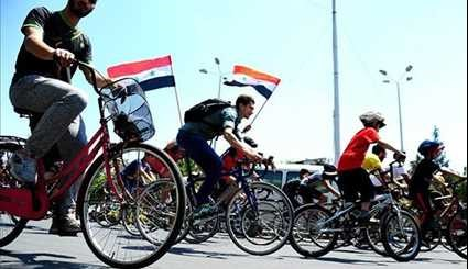 Syrians Take Part in Cycling Marathon to Mark Martyrs' Day in Damascus