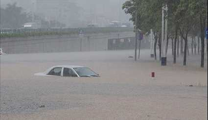 Rainstorms Cause Floods, Trap Cars in South China's Guangzhou