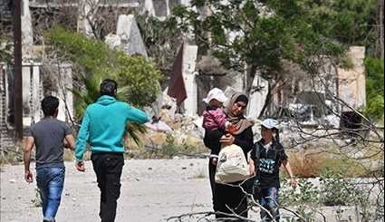 Syrian Residents Return to Qaboun District in Northeastern Damascus