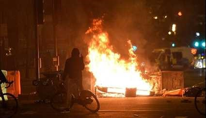 Riot Police on Streets of London as Protesters Set Fire to Barricades over Death of 20-Year-Old Rashan Charles