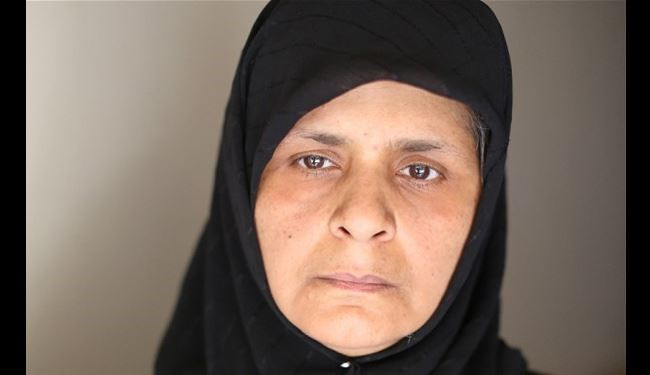 Syrian Mother: I saw rebels kill my son