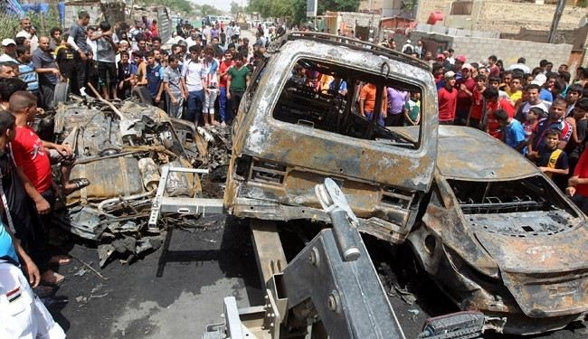 Car blast kills 12 at protest camp in central Iraq