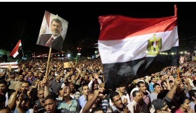 Thousands rally in Egypt, urging Morsi return
