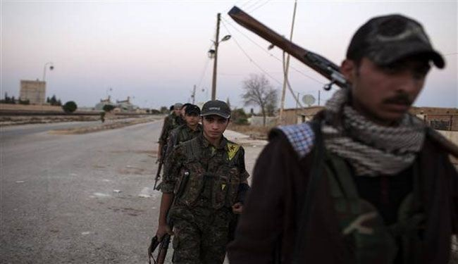 Kurd fighters seize Syrian border post from al-Qaeda