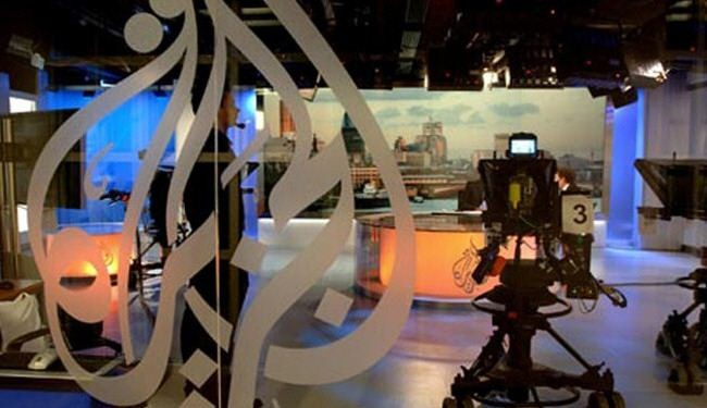 Egyptian forces raid Al Jazeera office, arrest 11