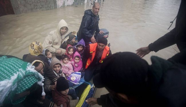 Thousands leave home in besieged flooded Gaza
