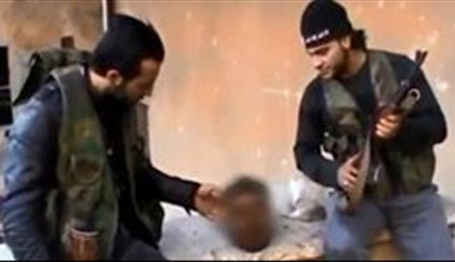 Terrorists insult, feed slain Syrian soldier's head: Video