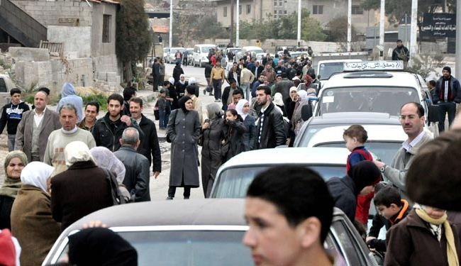 Displaced Syrians return to Barzeh after security restored
