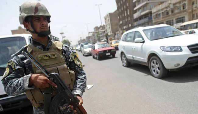 Iraqi troops free officials taken as hostage in Baghdad