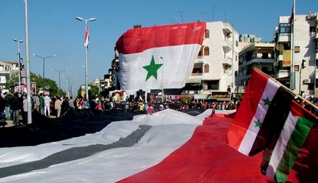 Syrians march in Latakia to support their national army
