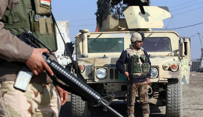 Iraqi troops battle to retake northern town from militants