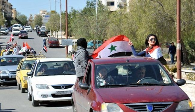 Syrians launch pro-government rallies in different cities