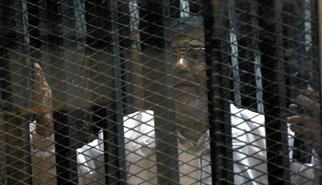 Morsi's trial on murder charges adjourns amid objection