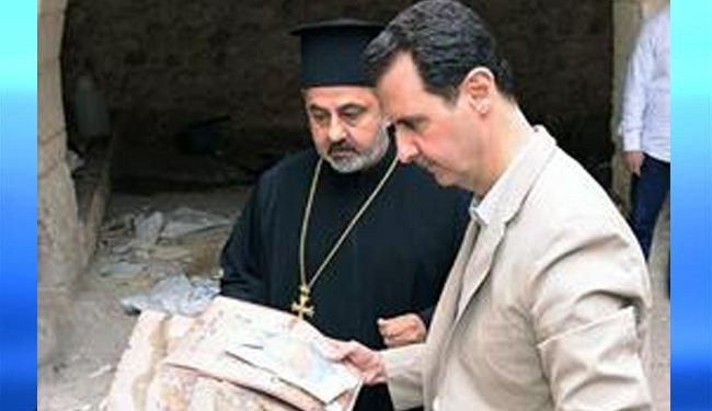 Assad visits recaptured Christian town