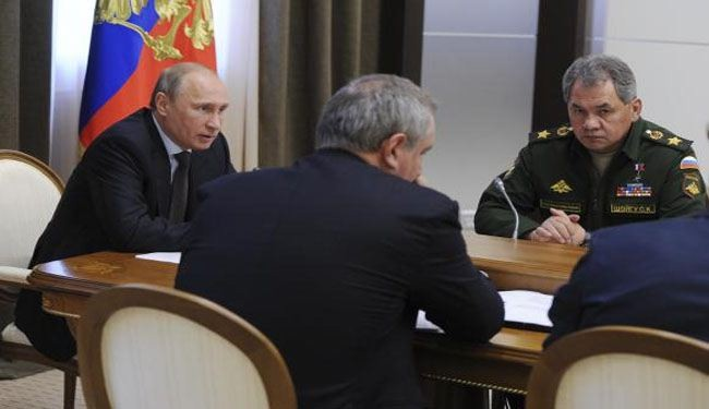 Putin orders troops back from border after drills