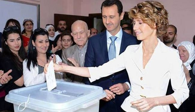 In picture: Polls open in Syria's presidential vote