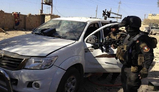 Iraqi security forces seize 20 arms-loaded vehicles en route to Karbala