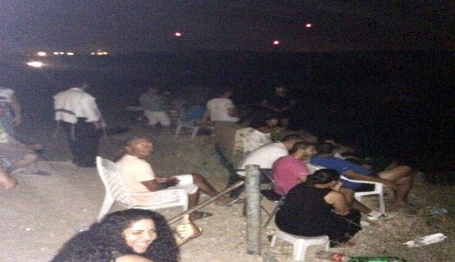 Theater of war: Israelis watch, cheer Gaza airstrikes