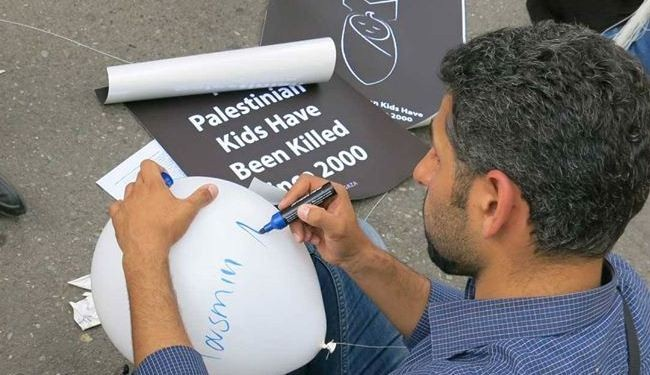 Iranians protest Israeli terror; One balloon for each murdered Gaza kid