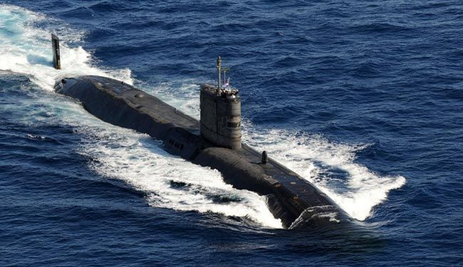 Russia navy forces US submarine to flee its waters