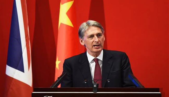UK's Hammond: Assad Must Go but Might Need to Talk to Him