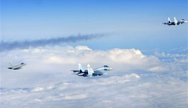 Russian DM Plane Escorted by Su-27s Trailed by NATO Typhoon Jets over Baltic