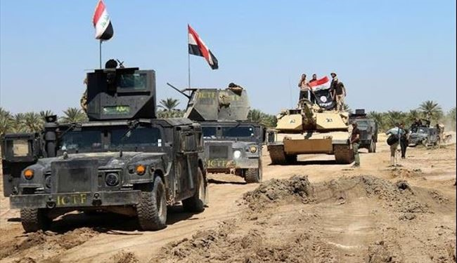 Iraqi Forces Take Full Control over Heet Town and Rais the Iraqi Flag