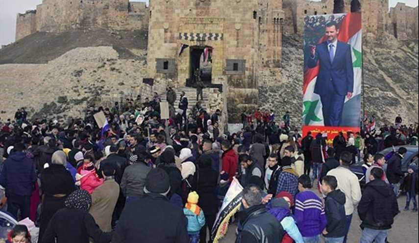 Aleppo Residents March to Celebrate Victory over Terrorism