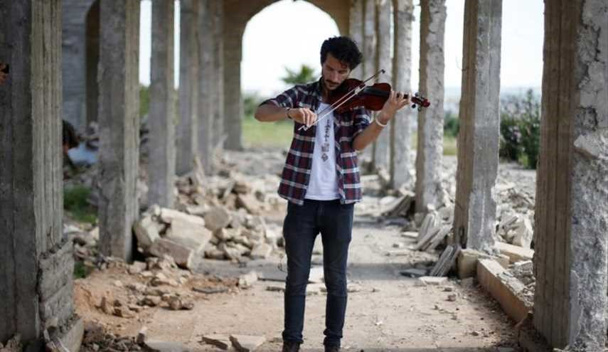 Iraqi violinist returns to play Mosul after ISIS