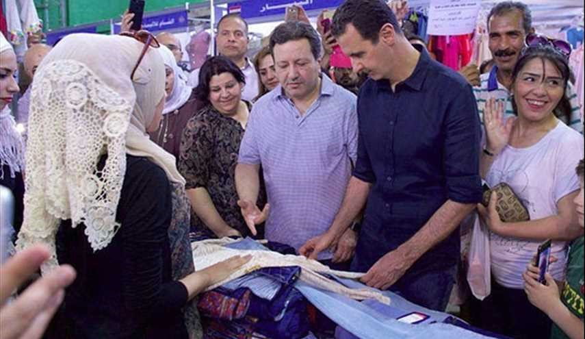Assad Visits Exhibition, Takes Selfies with Syrians