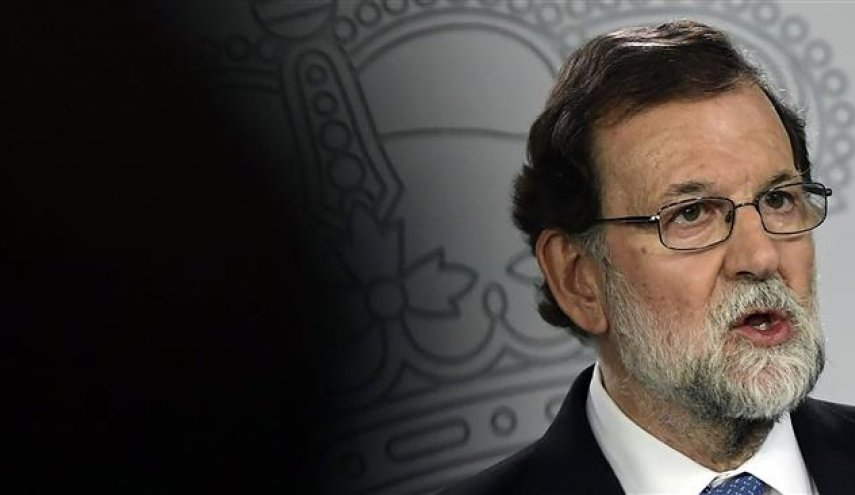 Spanish premier dismisses Catalan government, parliament