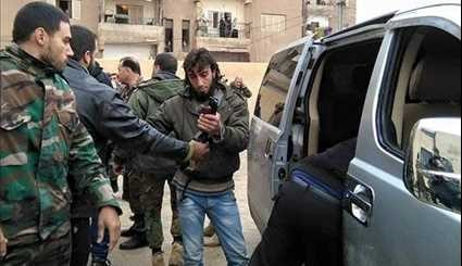 Tens of Militants Surrender to Syrian Authorities in Damascus