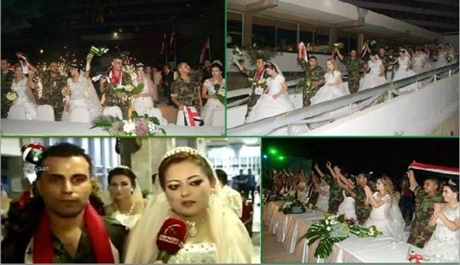Syria soldiers, brides in group wedding
