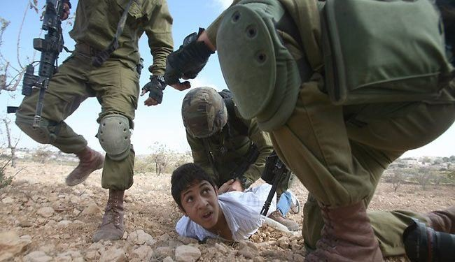 Israeli soldiers beat, chain Palestinian child