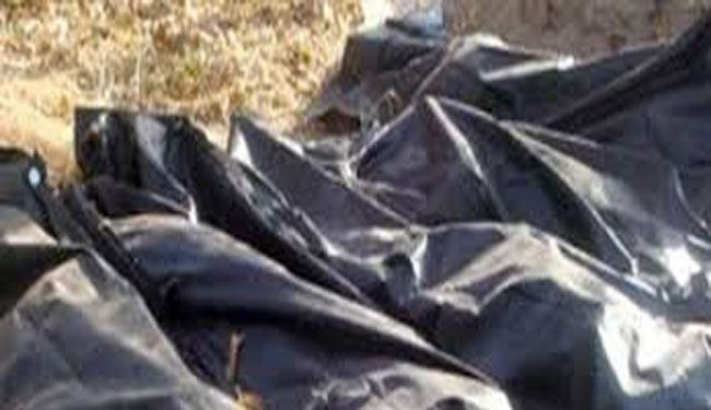 20 Bodies Dressed in Red Found in Grave in Tikrit