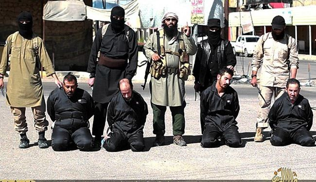 "Shocking Images; ISIS Beheads 4 More Iraqis as ""Spy"""