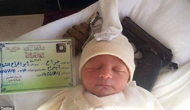 A Handgun & Hand Grenade Are The ISIS New Born Baby's Toys + pics