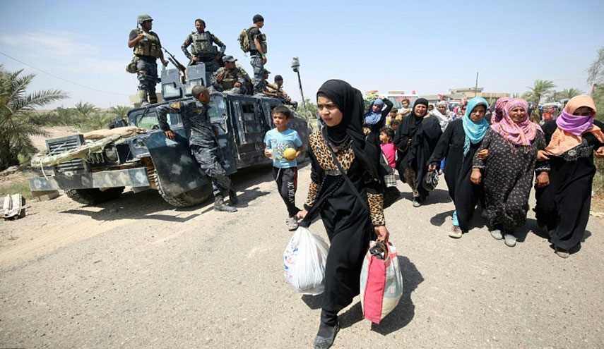 Hashd Al-Shaabi Frees 200 Iraqi Families from ISIL's Grip in Tal Afar