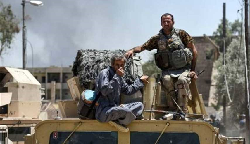 Iraqi Civilians Escorted to Safety as Army Continues Battle
