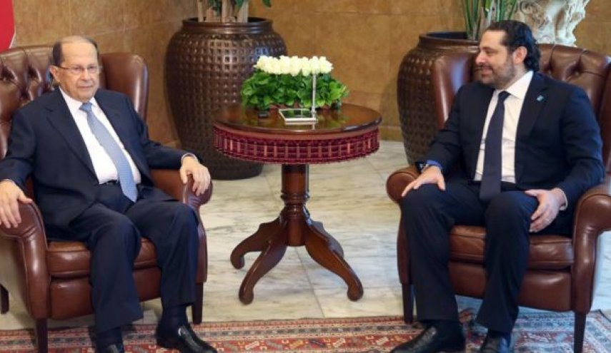Lebanon's president says crisis over with PM Hariri's France trip