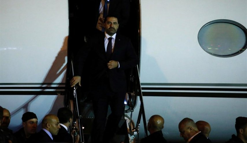 Lebanon's PM returns to Beirut after abrupt resignation while in Saudi Arabia